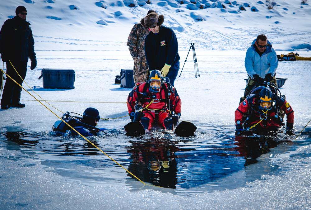 Riverside County Sheriff's Office Dive Team members prepare to enter the water at Deer Creek Reservoir