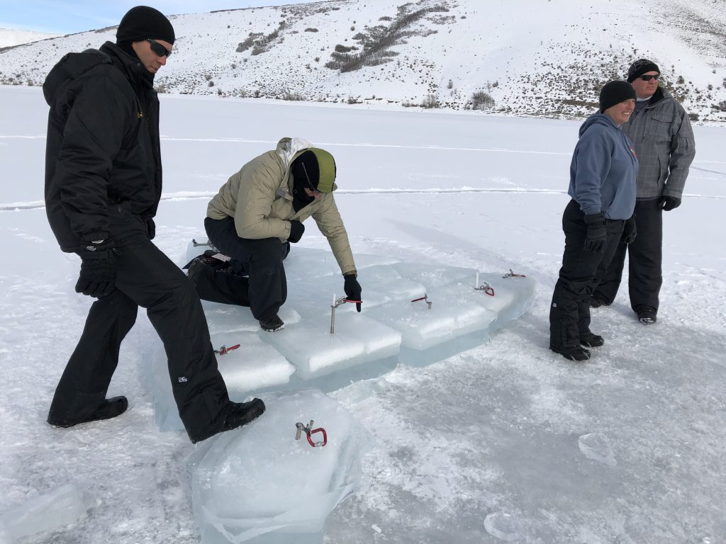 Riverside County Sheriff's Office dive team members prepare to return blocks of ice into the frozen lake.