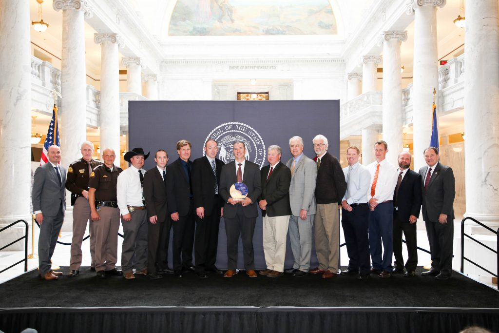 Members of the DPS Aero Bureau stand on stage as they receive the Governor's Award for Excellence.