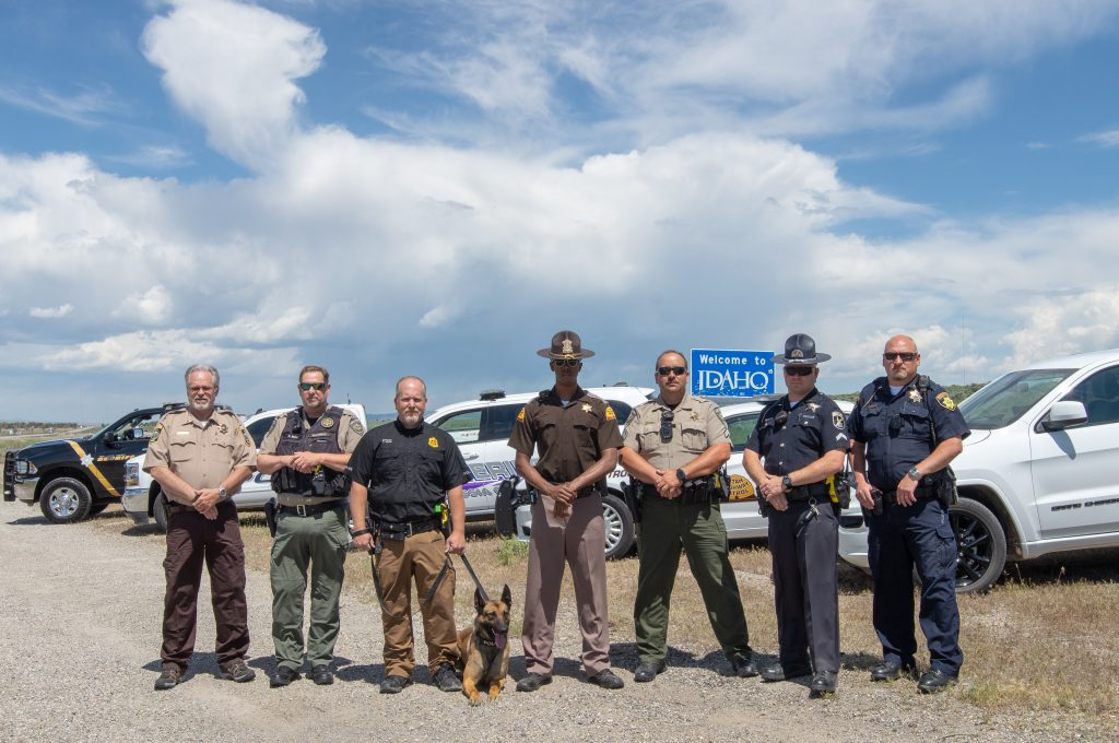 Officers from multiple different agencies stand by their vehicles at the Utah-Idaho border as part of the Click It or Ticket Border to Border Enforcement effort.