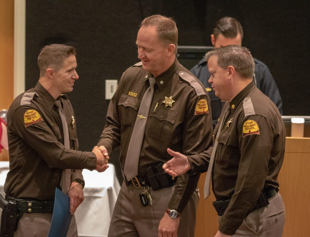 UHP admin shakes hands with new Trooper.