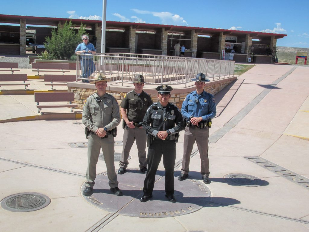 State troopers from New Mexico, Colorado, Utah and Arizona stand at the Four Corners Monument.