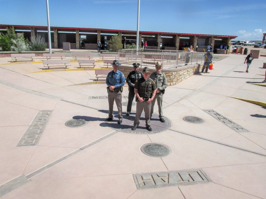 State troopers from New Mexico, Colorado, Utah and Arizona stand at the Four Corners Monument as part of the Border to Border seat belt enforcement initiative.