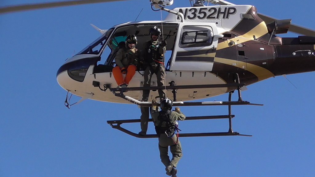 The DPS helicopter performs a hoist rescue operation practice.