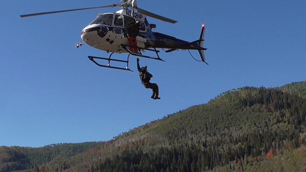 The DPS helicopter performs a hoist rescue drill.