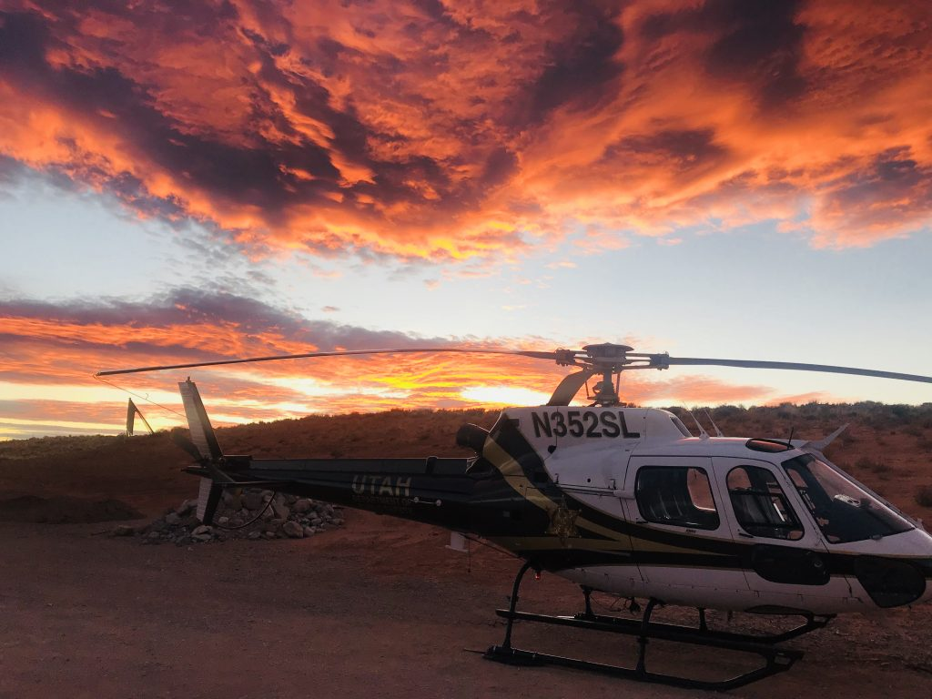 The DPS helicopter with a beautiful cloud formation in the background.