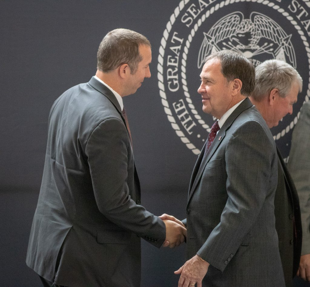Governor Herbert shakes Chief Pilot Luke Bowman's hand.