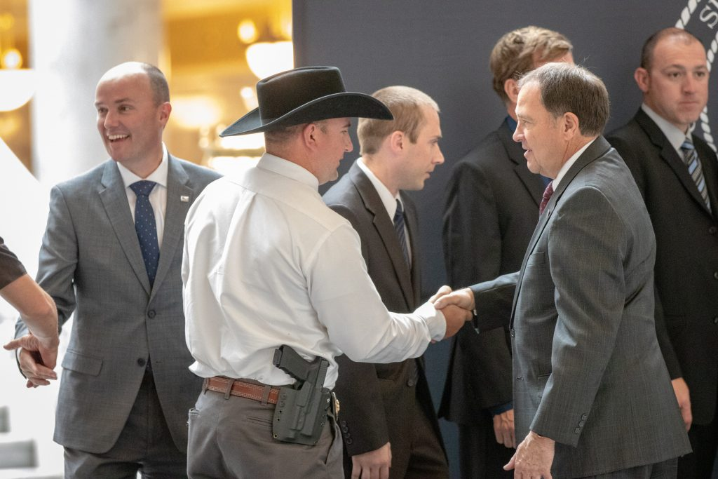 Governor Herbert shakes TFO Sgt. Shelby's hand.