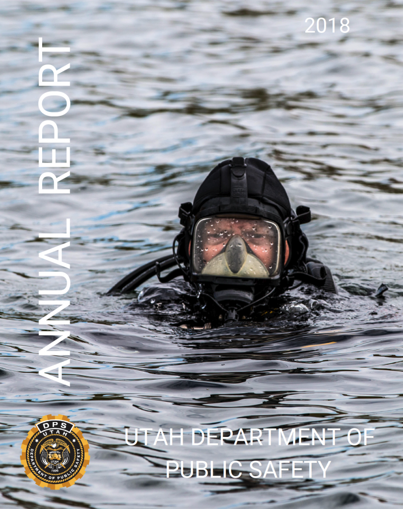 Cover of the 2018 DPS annual repot shows a DPS diver in the water.