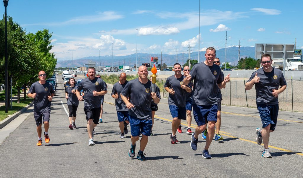 POST Director Major Stephenson holds the torch during the Special Olympics Torch Run.