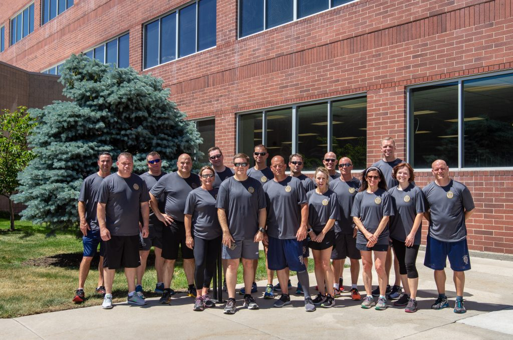 Members of UHP, DPS Administration and POST pose for a photo after the Special Olympics Torch Run.