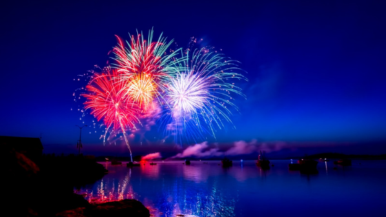 Fireworks display over water.