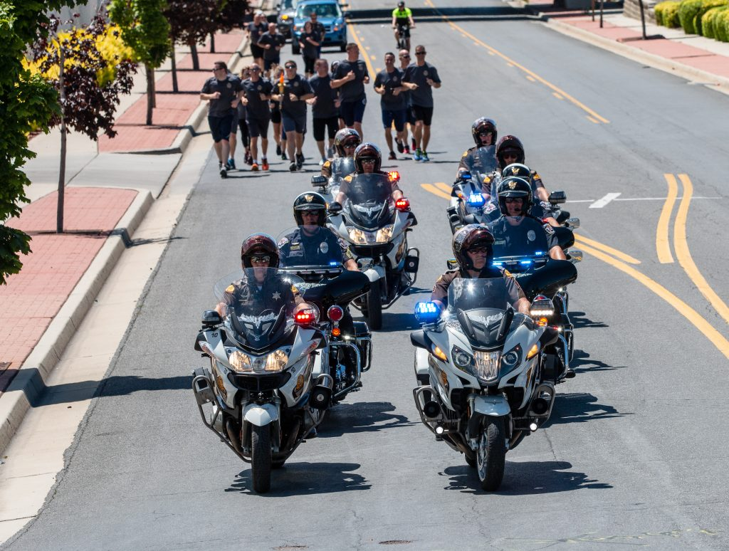 UHP Motors escort runners during the Torch Run.