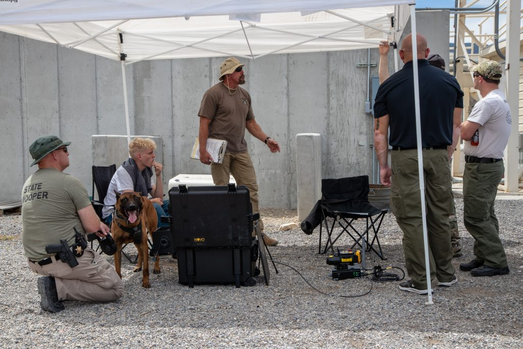 Trooper Elmer and K9 Rocco participate in a K9 integration bomb squad scenario.