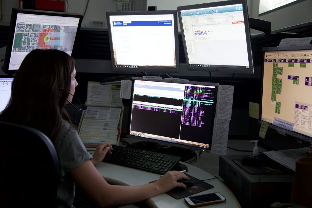 Dispatcher at Box Elder Communications Center takes a call