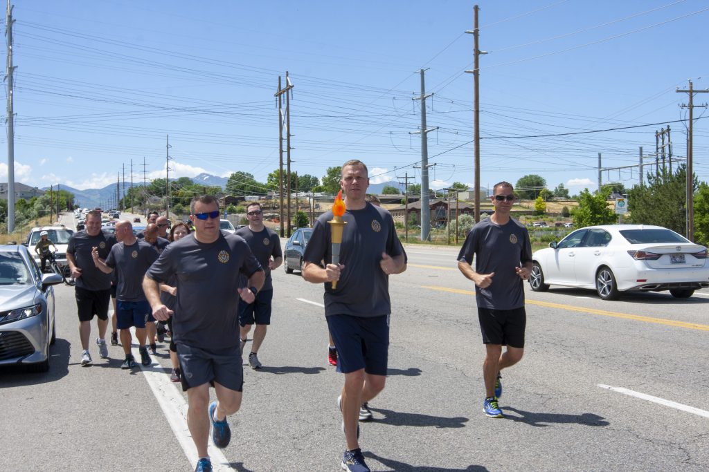 Commissioner Anderson holds the torch and prepares to run during the Special Olympics Torch Run.
