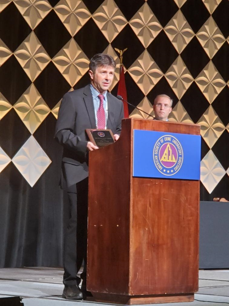 Jay Henry accepts an award at the American Society of Crime Laboratory Directors.
