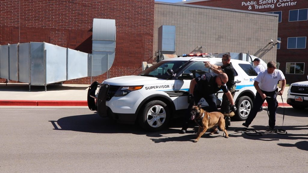 K9 Ranger is ready to spring into action, standing by the WVCPD vehicle while Sgt. Palmer holds his leash.