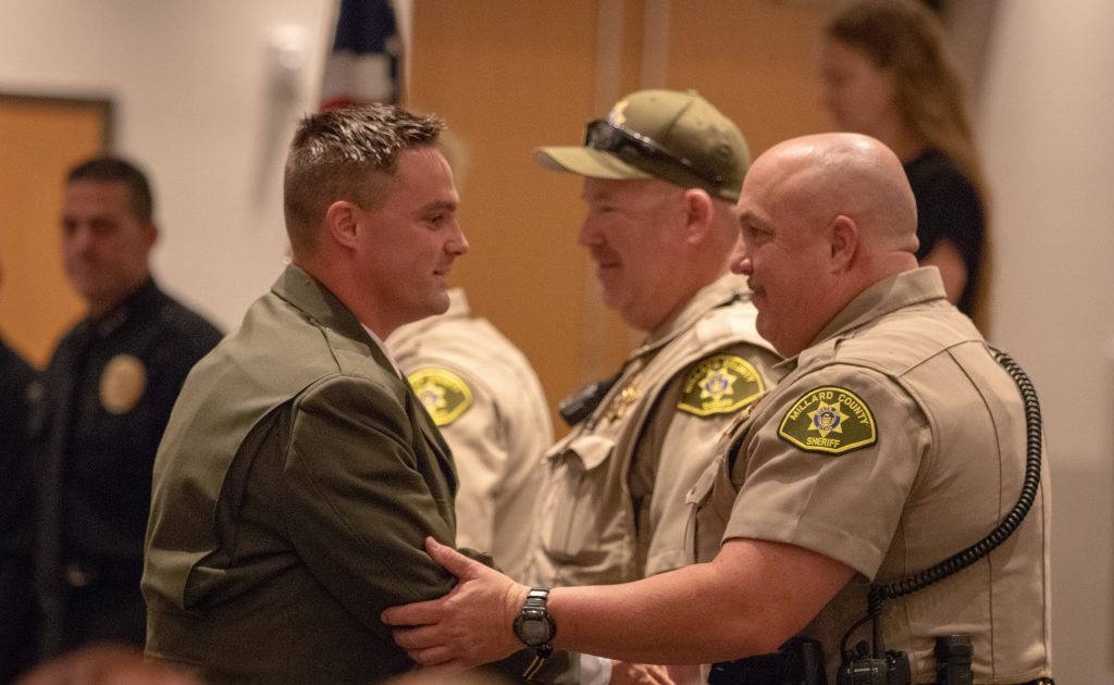 New Millard County Deputy shakes the hand of another deputy after receiving his POST certificate