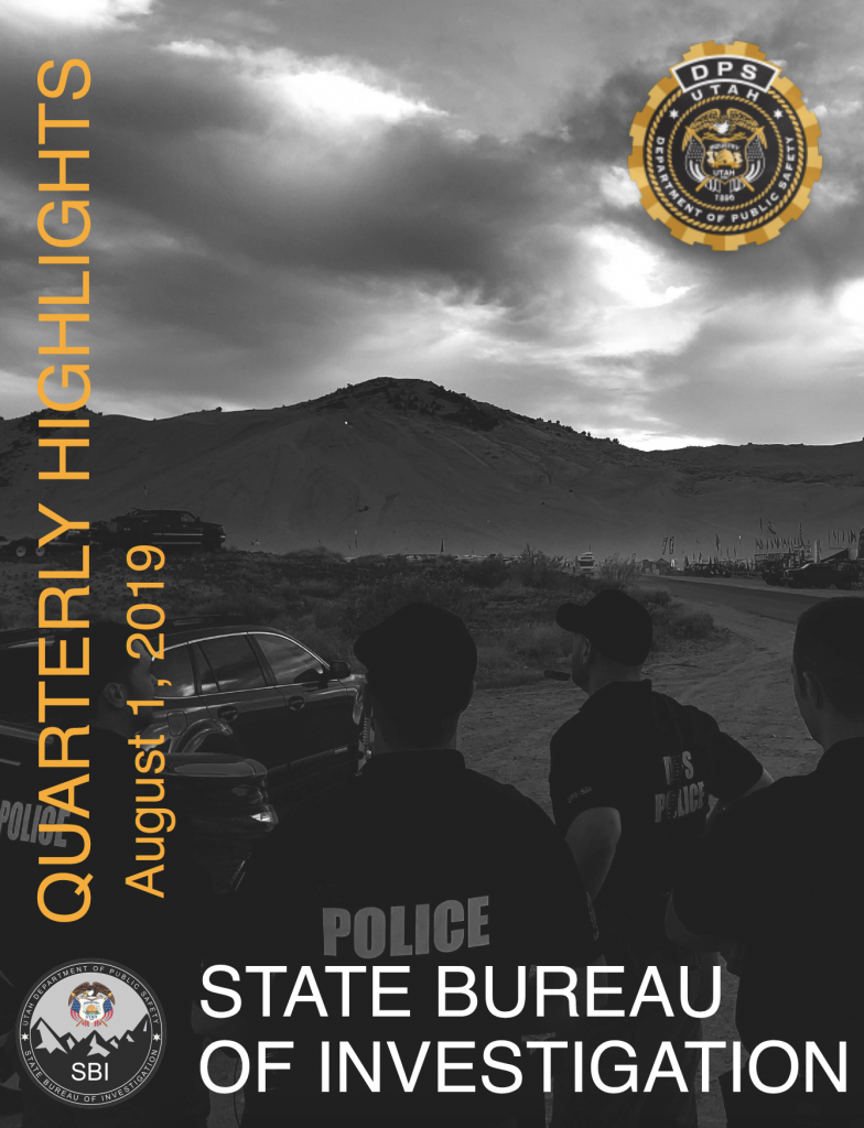 Cover of SBI Quarterly Highlights shows DPS agents at the sand dunes for Easter. They are looking out on a field with off road vehicles in it.