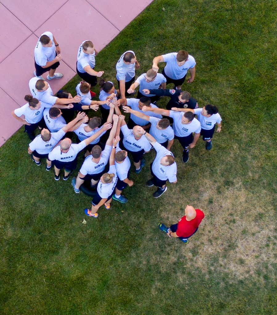 Aerial view of group of cadets gathering together to give their class cheer.