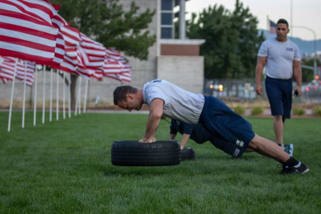Two cadets perform push ups on the tire at the north end of the healing field.