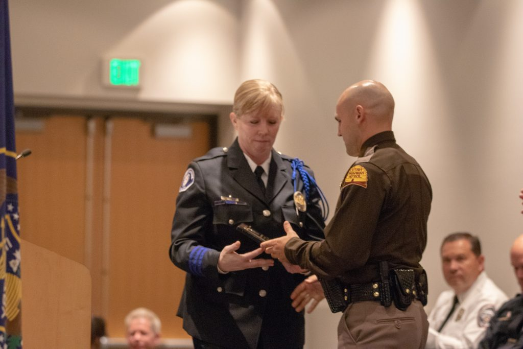 American Fork Police Department Sgt. Jennifer Nakai presents Trooper Alexander McCampbell with the Outstanding Achiever Award.