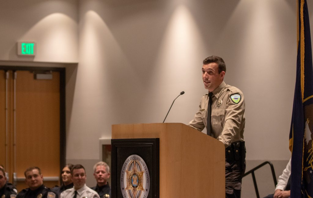 New Weber County Deputy Rosett stands at the podium and delivers the class response.