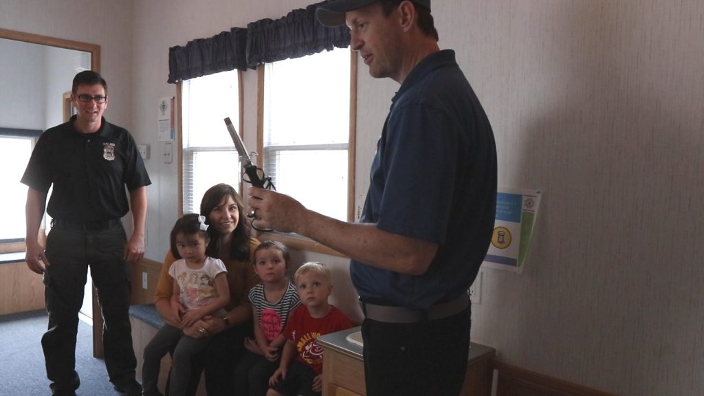Deputy Fire Marshal discusses appliance and electricity safety with preschool students inside the life safety trailer.