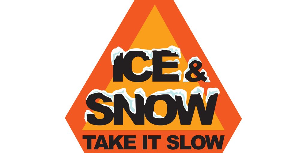 """Orange Triangle warning sign reads """"Ice and snow, take it slow"""""""