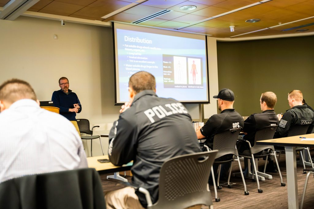 Toxicology lab director Matt Slawson presents to police officers at SBI training.