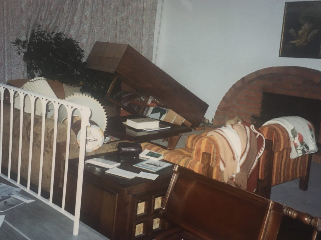 living room furniture toppled after an earthquake