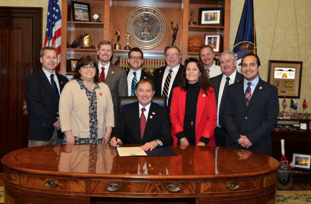 Be Ready Utah staff pose with Governor Herbert in his formal office for the signing of a proclamation