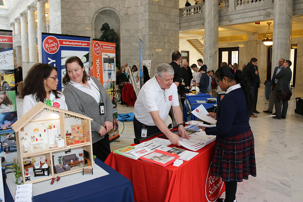 Be Ready Utah staff explain emergency preparedness to patrons at the annual preparedness day on the hill event at the Utah State Capitol