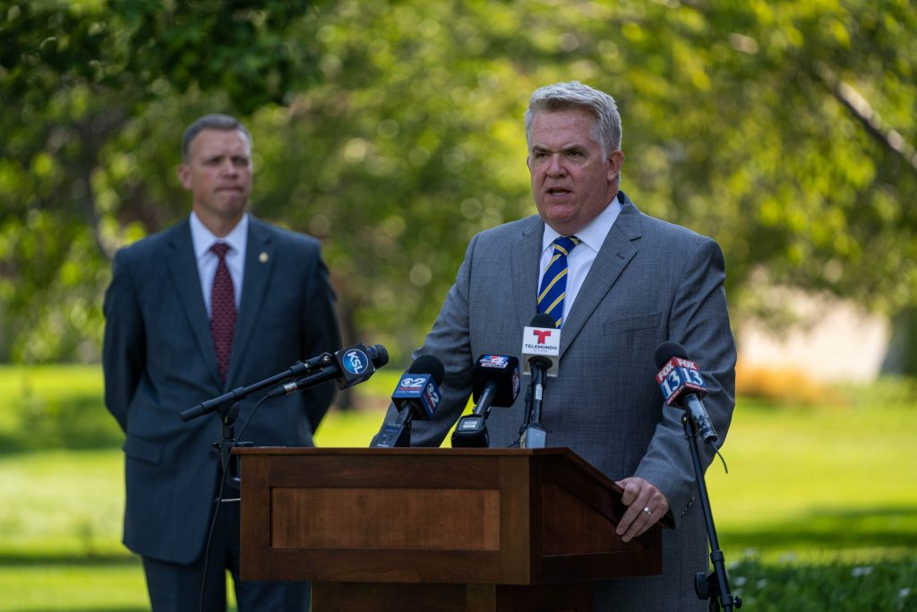 U.S. Attorney John Huber addresses the media as Commissioner Anderson looks on.