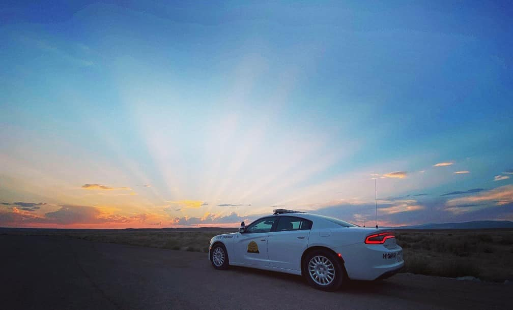 Image shows a UHP Charger with a beautiful sunset sky - the sun is below the horizon but the horizon is orange and there are long light streaks in the blue sky.