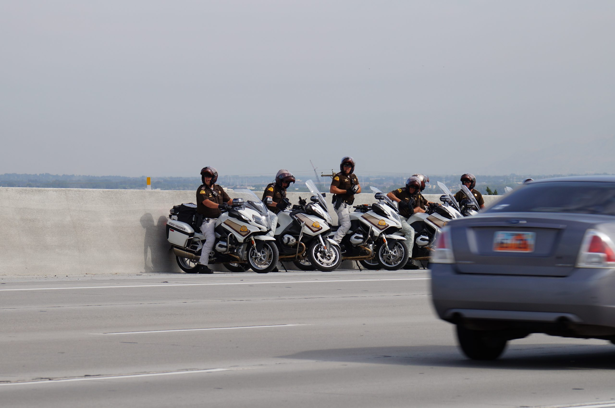 Image shows multiple motorcycles positioned in the median conducting speed enforcement.