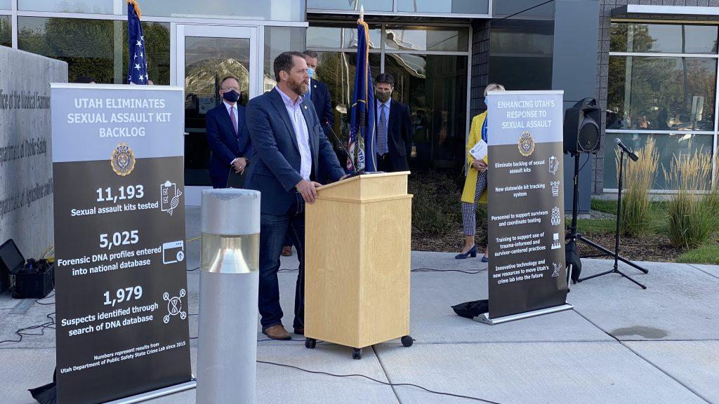 Utah State Senator Jake Anderegg speaks at the podium at the press conference marking the elimination of Utah's sexual assault kit backlog.