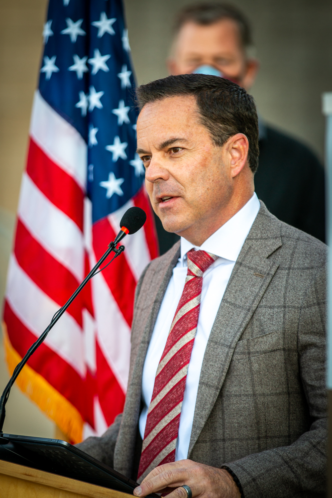 Utah House Speaker Wilson speaks at the podium at the press conference marking the elimination of Utah's sexual assault kit backlog.