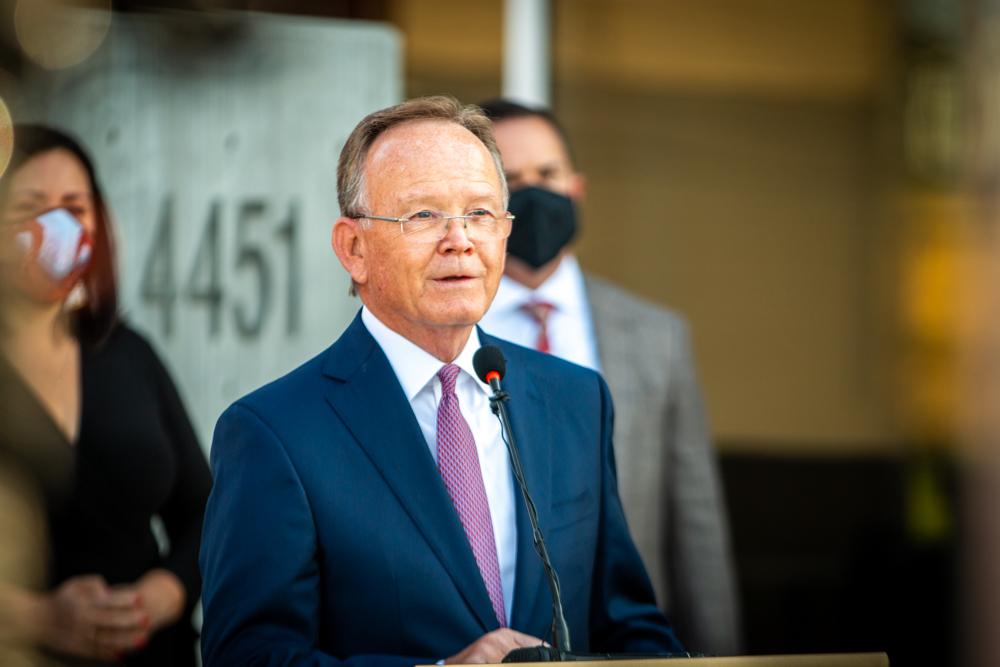 Utah Senate President Adams speaks at the podium at the press conference marking the elimination of Utah's sexual assault kit backlog.