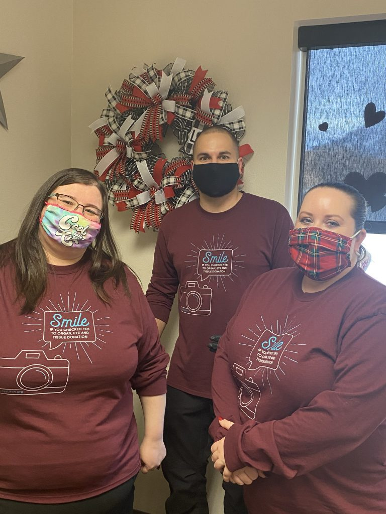 Driver License Division employees pose wearing their shirts for the organ donor partnership campaign with Donor Connect.