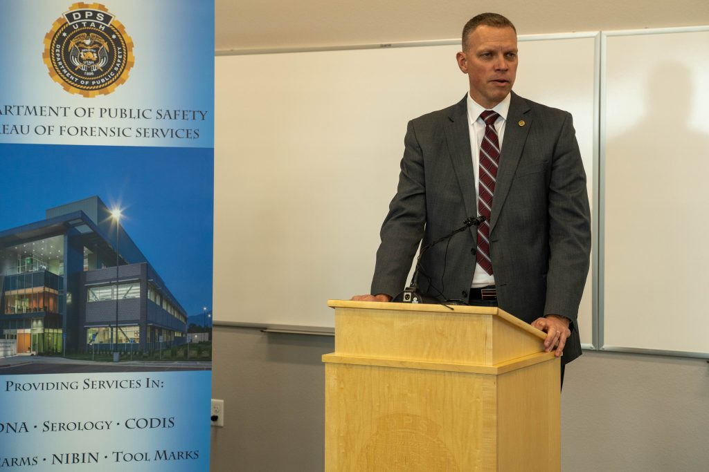 Commissioner Anderson stands at the podium and speaks about the crime lab opening.