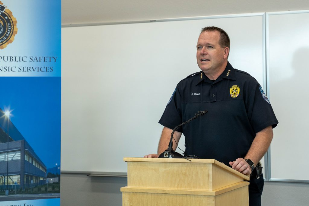 Cedar City Police Chief Darrin Adams stands at the podium and speaks about the crime lab opening.