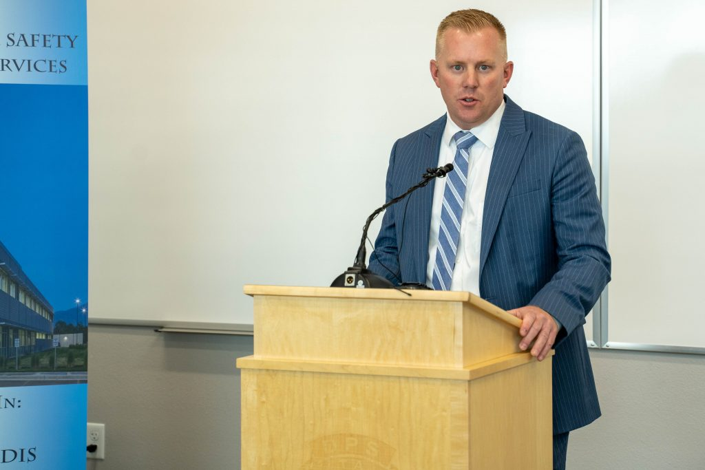 Iron County Attorney Chad Dotson stands at the podium and speaks about the crime lab opening.