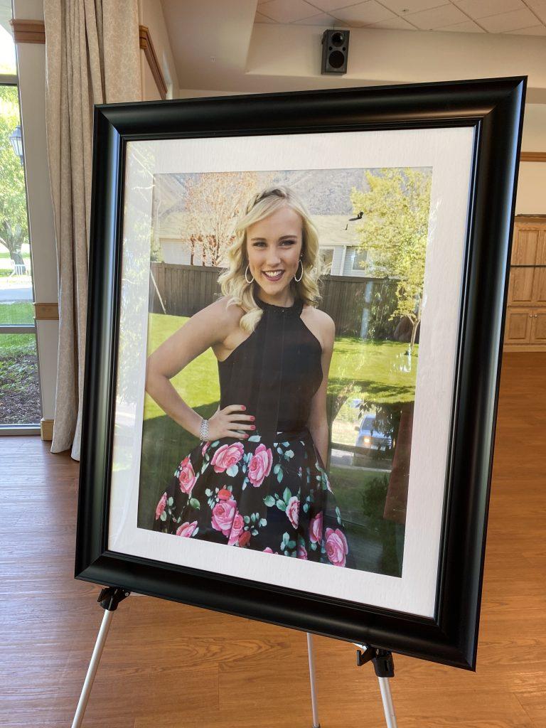 Large portrait shows Kathrynn Shaw in a formal dress.